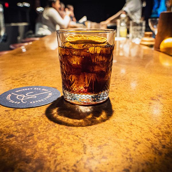 a signature cocktail at jockey silks bourbon bar