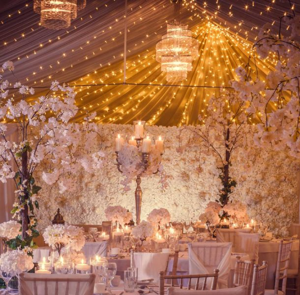 Room decorated for a wedding with lights and flowers.