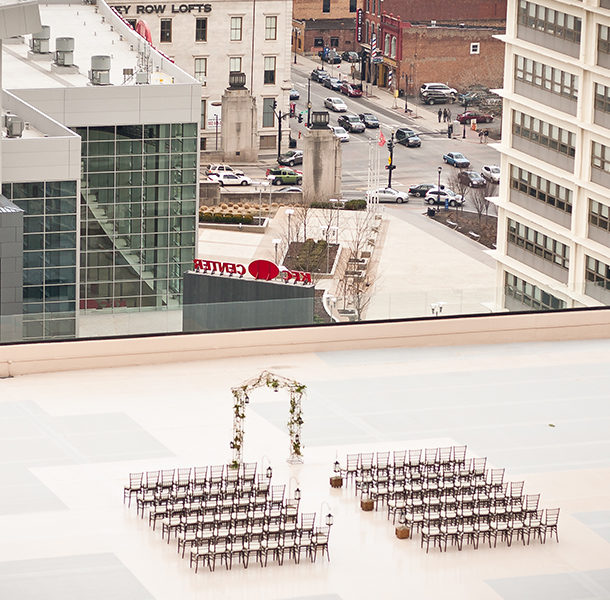 The setting of a rooftop wedding located on top of the Galt House's East Tower with a view looking east over the KFC Yum! Center