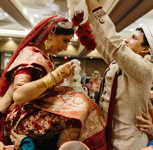 a bride and groom at a traditional Indian wedding in the grand ballroom