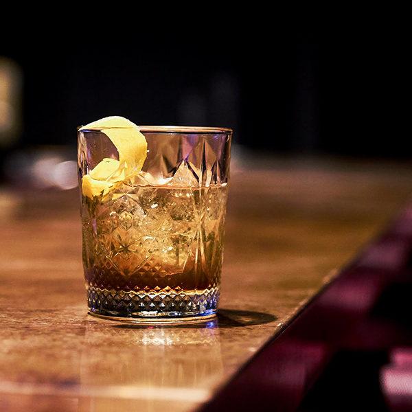 an old-fashioned cocktail at jockey silks bourbon bar