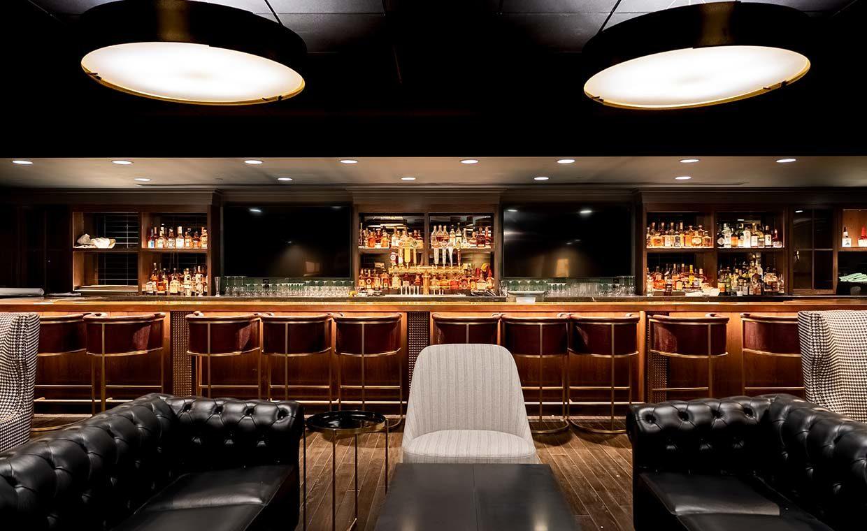 the bar at jockey silks bourbon bar