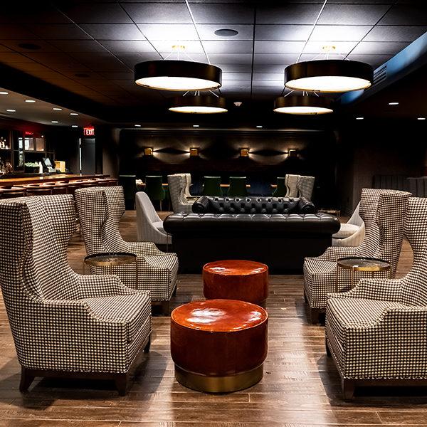 the interior of jockey silks bourbon bar