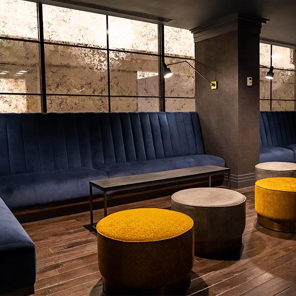 blue velvet couches inside jockey silks bourbon bar