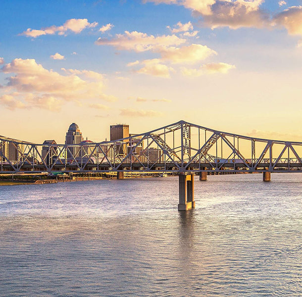 the george rogers clark bridge over the ohio river with downtown louisville in the background