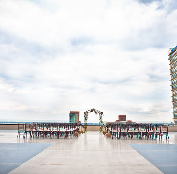 A rooftop wedding setting with a view of Louisville atop the Galt House's east tower