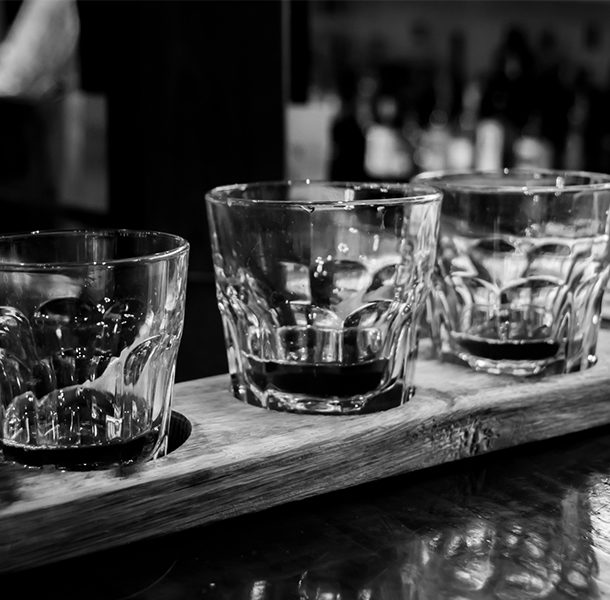 three glasses with bourbon as part of a bourbon flight at Down One Bourbon Bar