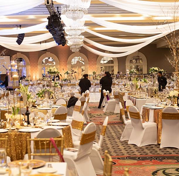 the grand ballroom decorated for unbridled eve in gold and white